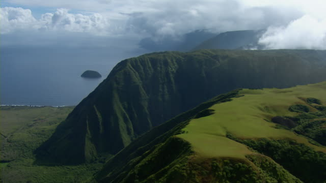 Aerial view of volcanic mountains on the coast of Kalaupapa National Historical Park on the Hawaiian Island of Molokai.