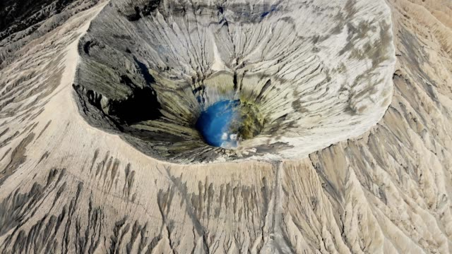 aerial view of volcano bromo crater with smoke in east java, indonesia - indonesia volcano stock videos & royalty-free footage