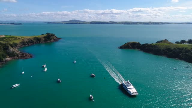 aerial view of waiheke island with rangitoto island in background. - ferry stock videos & royalty-free footage