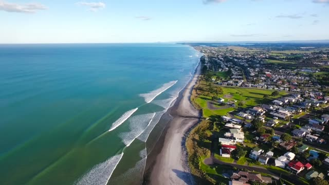 aerial view of waihi beach coastline, bay of plenty, new zealand. - bay of water stock videos & royalty-free footage