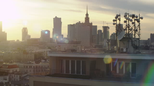 aerial view of warsaw center at sunset. residetial buildings and skyscrapers seen from above, %g transmitters on a rooftop - warsaw stock videos & royalty-free footage