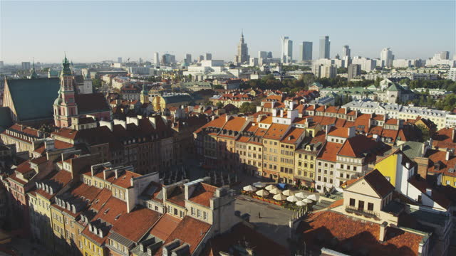 aerial view of warsaw old town with distant skyline. brick tenement houses and narrow streets - warsaw stock videos & royalty-free footage
