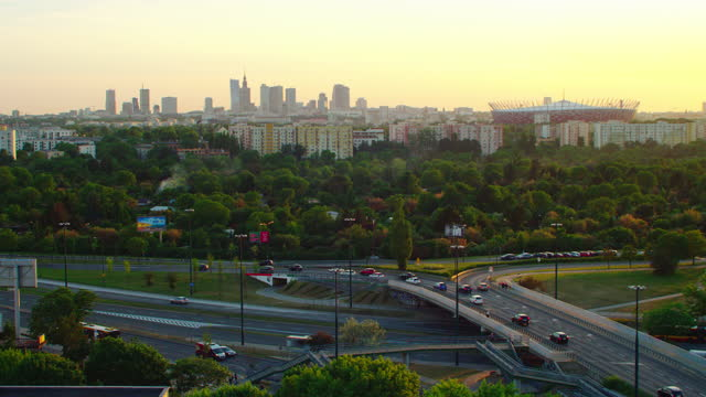 aerial view of warsaw. residential area and distant skyscrapers skyline at sunset - warsaw stock videos & royalty-free footage