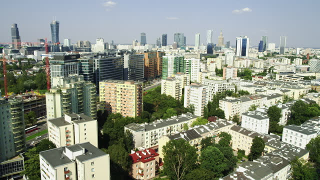 aerial view of warsaw. residential area seen from above, skyscrapers in distance - warsaw stock videos & royalty-free footage