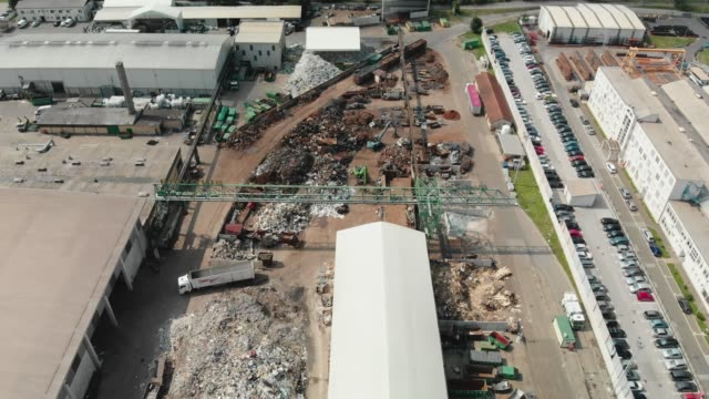 aerial view of waste recycling facility in slovenia, situated next to a train rails - dump truck stock videos and b-roll footage