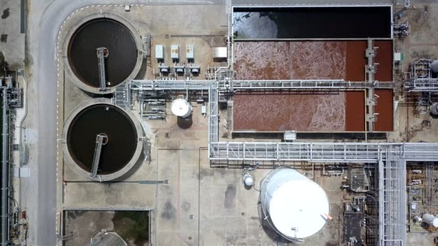 vidéos et rushes de aerial view of waste water treatment system in oil refineries - station