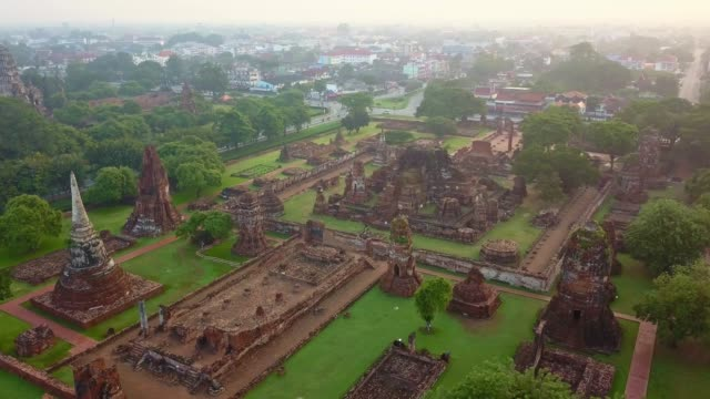aerial view of wat mahathat is a buddhist temple, part of the ayutthaya world heritage historical park, thailand - bagan stock videos & royalty-free footage