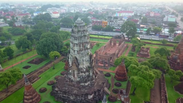 aerial view of wat ratchaburana is a buddhist temple in the ayutthaya historical park, ayutthaya, thailand. the temple's main prang is one of the finest in the city. - bagan stock videos & royalty-free footage