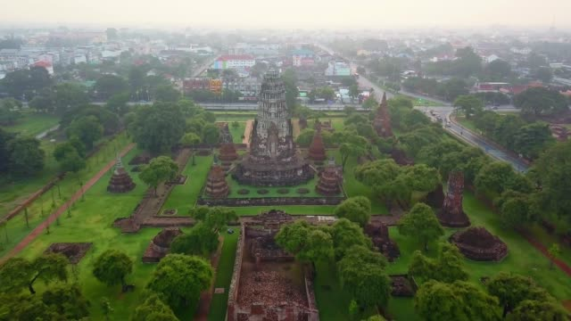 aerial view of wat ratchaburana is a buddhist temple in the ayutthaya historical park, ayutthaya, thailand. the temple's main prang is one of the finest in the city. - temple building stock videos & royalty-free footage