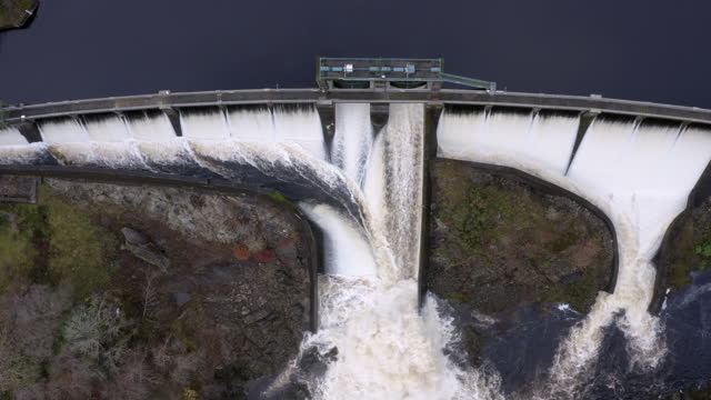 aerial view of water flowing over a hydro electric dam in dumfries and galloway south west scotland - galloway scotland stock videos & royalty-free footage