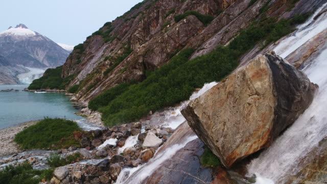aerial view of waterfall along endicott arm, southeast alaska - area selvatica video stock e b–roll