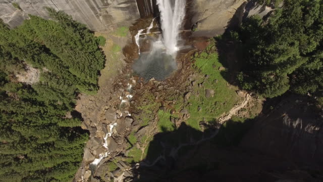 aerial view of waterfall in forest glen - yosemite national park stock videos and b-roll footage