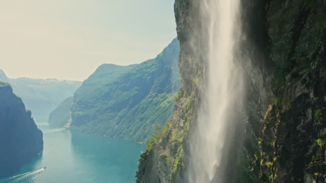 aerial view of waterfall in geiranger - idyllic stock videos & royalty-free footage