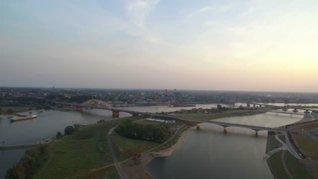 stockvideo's en b-roll-footage met aerial view of watermanagement next to city - brug mens gemaakte bouwwerken