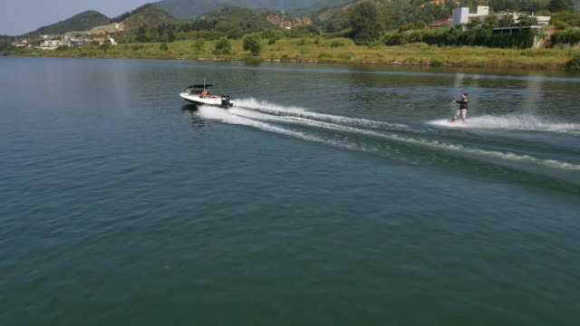 aerial view of waterskiing at bukhangang river - wakeboarding stock videos and b-roll footage
