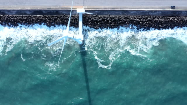 aerial view of waves and windmill - landscaped stock videos & royalty-free footage