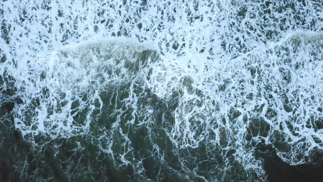 aerial view of waves break on the beach and sand before the storm - pacific islands stock videos & royalty-free footage