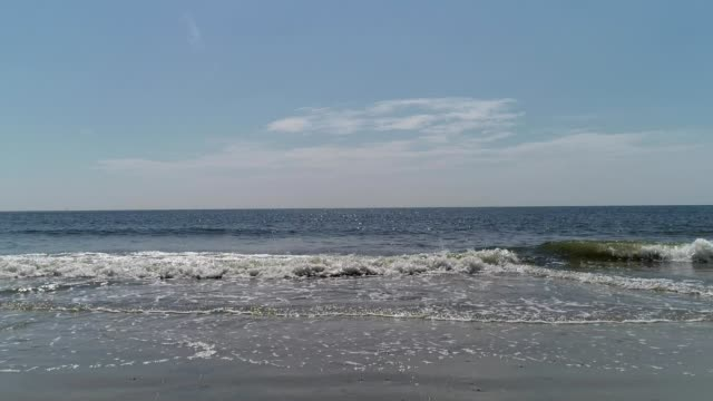 Aerial view of Waves brushing up on shore of Tybee Island Georgia