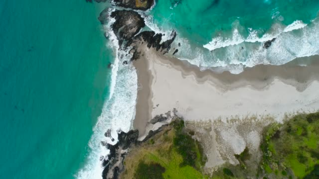 aerial view of waves splashing on coast. - new zealand culture stock videos and b-roll footage