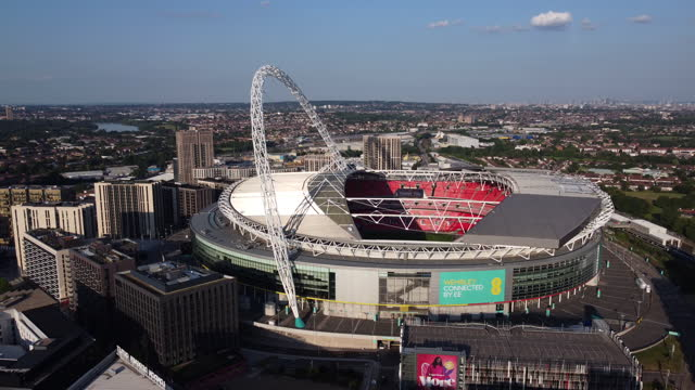 aerial view of wembley stadium and arch. tracking shot. - arch stock videos & royalty-free footage