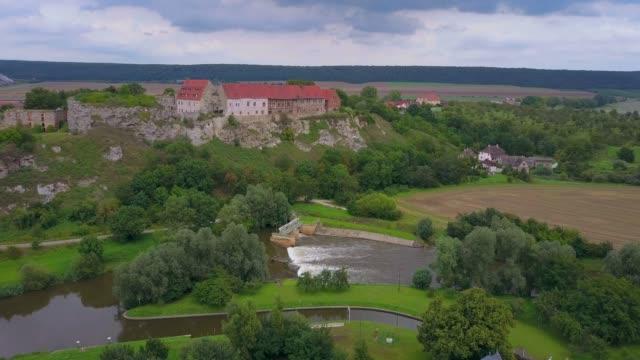 stockvideo's en b-roll-footage met aerial view of wendelstein castle and unstrut river, saxony-anhalt, germany - rond de 13e eeuw