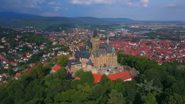 Aerial view of Wernigerode Castle towering above the town of Wernigerode, Harz, Saxony-Anhalt, Germany