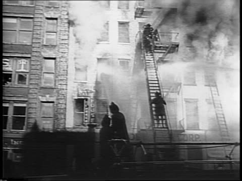 aerial view of west 42nd street / firefighters dousing building with water as smoke billows / closeup of charred residential hotel sign 'standard... - 42nd street stock videos & royalty-free footage