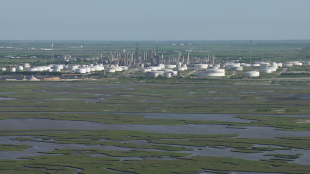 aerial view of wetland with oil and gas refinery plant in corpus christi, texas. - corpus christi texas stock videos & royalty-free footage