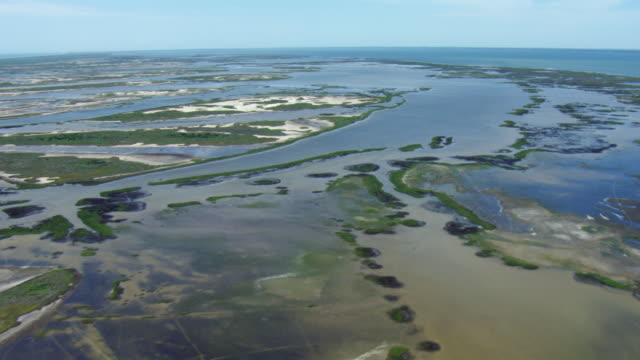 vidéos et rushes de aerial view of wetlands on san jose island with aransas bay, texas. - gulf coast states