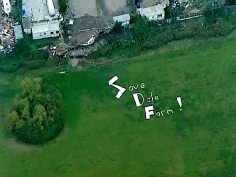 aerial view of white big letters save dale farm in the field next to dale farm essex - デールファーム点の映像素材/bロール