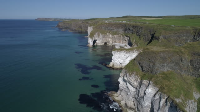 aerial view of white cliffs on green antrim coastline, ireland - bay of water stock videos & royalty-free footage