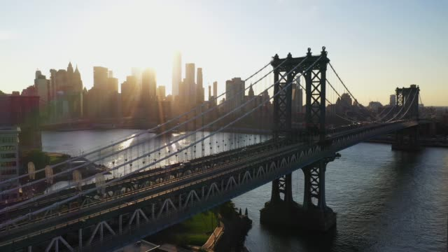 aerial view of williamsburg bridge at sunset - bridge built structure stock videos & royalty-free footage