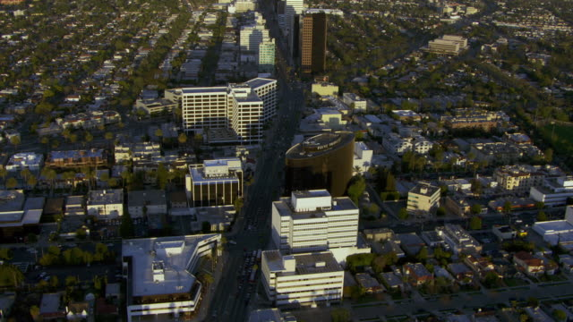 aerial view of wilshire boulevard at beverly hills, and zoom towards downtown los angeles. - wilshire boulevard stock videos & royalty-free footage