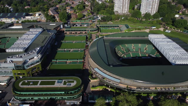 aerial view of wimbledon tennis courts. tracking shot from centre court to court no.1. - greater london stock videos & royalty-free footage