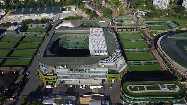 aerial view of wimbledon tennis courts. tracking shot from court no.1 to centre court. - arts culture and entertainment stock videos & royalty-free footage