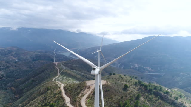 aerial view of wind power generators on the hill of andalusia, spain - medium group of objects stock videos & royalty-free footage