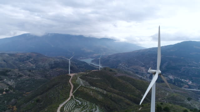Aerial view of wind power generators on the hill of Andalusia, Spain