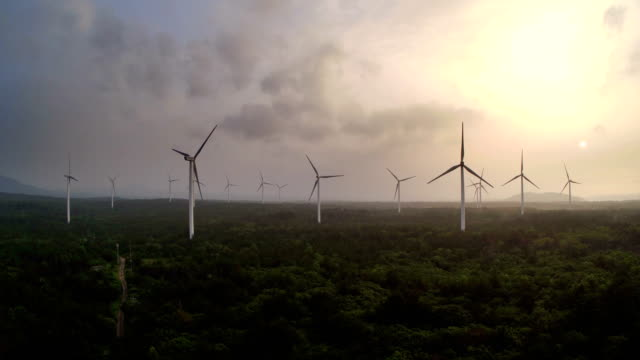 vidéos et rushes de aerial view of wind power generators - production d'énergie