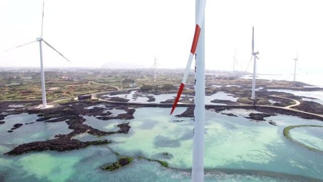 aerial view of wind power generators - turbine stock-videos und b-roll-filmmaterial
