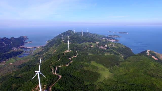 aerial view of wind turbin along sea, fujian,china. - hill stock videos & royalty-free footage