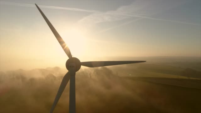 aerial view of wind turbine at sunset - wind turbine stock videos & royalty-free footage