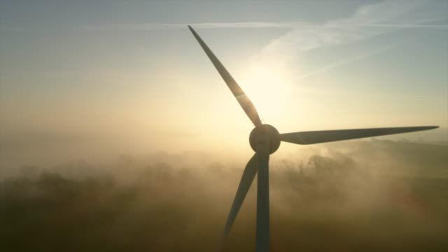 aerial view of wind turbine at sunset - windmill stock videos & royalty-free footage