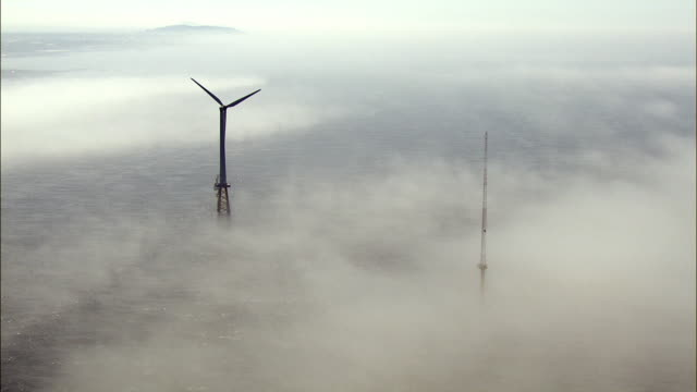 Aerial view of Wind Turbine in the fog
