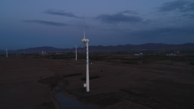 Aerial View of Wind Turbine on Sunset