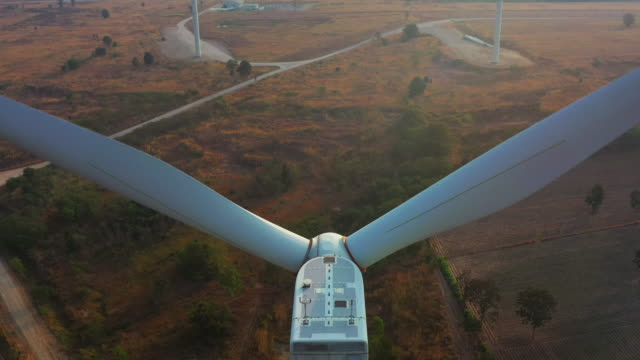 aerial view of wind turbine - sustainable resources stock videos & royalty-free footage