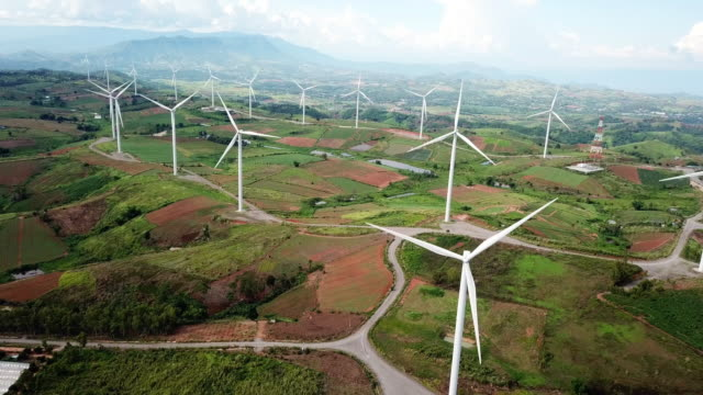 aerial view of wind turbines , alternative energy - mill stock videos & royalty-free footage