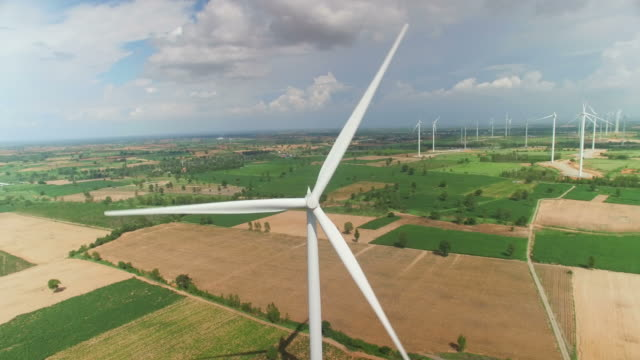 aerial view of wind turbines in blue sky - attrezzatura industriale video stock e b–roll