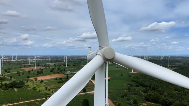 aerial view of wind turbines in the fields - place of work stock videos & royalty-free footage