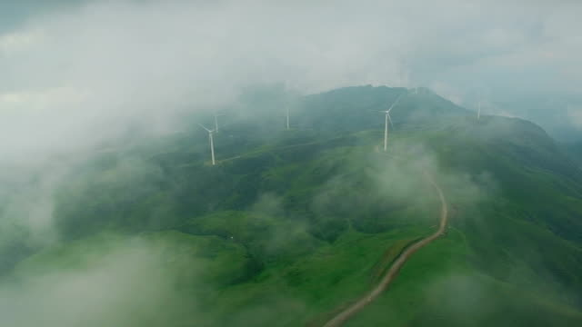 aerial view of wind turbines on wumeng prairie,guizhou,china. - famous place stock videos & royalty-free footage