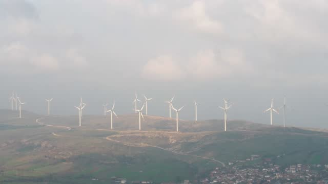 aerial view of wind turbines - sustainable resources stock videos & royalty-free footage